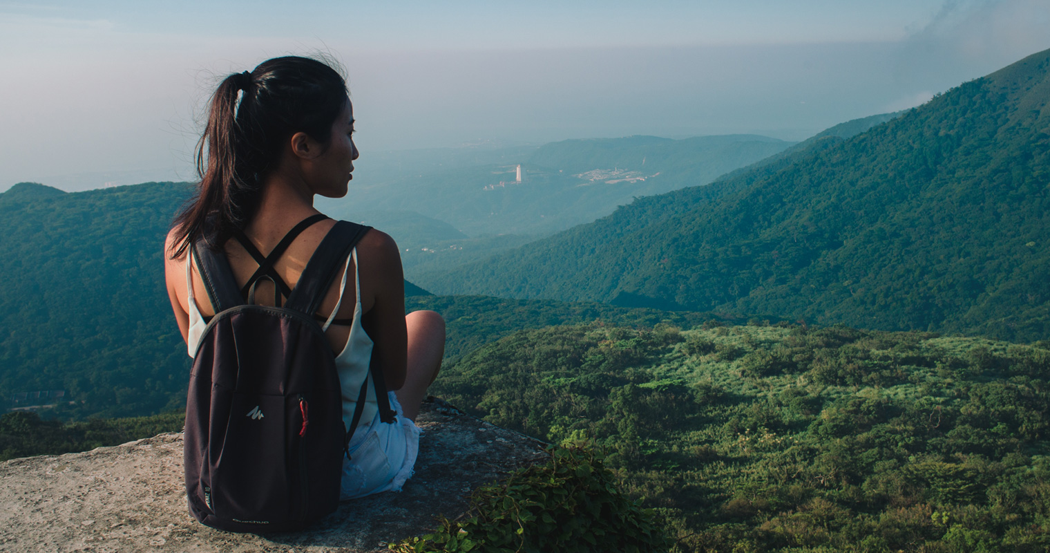 Girl at lookout point in Asia